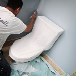 painting near toilet cover drop cloth